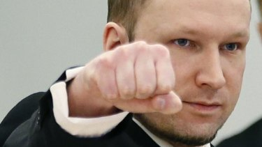 Anders Behring Breivik makes a right-wing salute at the start of the third day of his trial in Oslo.