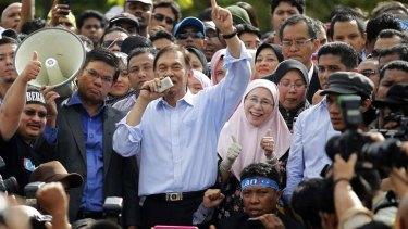 Outrage: The party of Malaysia's opposition leader Anwar Ibrahim, seen speaking at a rally last year, have protested against police brutality.