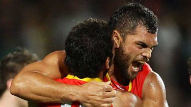 Karmichael Hunt celebrates his match-winning goal after the final siren during the Gold Coast Suns' match against Richmond in Cairns.