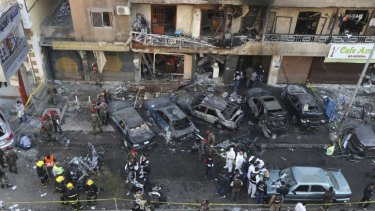 Lebanese army soldiers and forensic inspectors gather to examine the site of an explosion in the southern suburbs of the Lebanese capital Beirut.