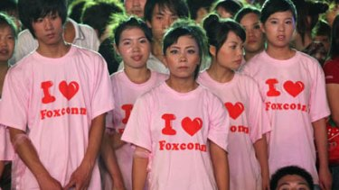 Foxconn employees attend a rally at the Foxconn campus in the southern Chinese city of Shenzhen.