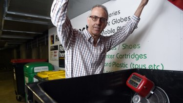 Gordon Streight opens one of the e-waste bins at the recycling depot in the underground car park at The Bauhaus apartment block in Pyrmont.