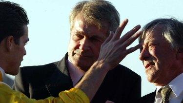Jockey Danny Nikolic speaks to Les Samba, centre, and trainer Bob Thomsen at a race meeting in 2004.