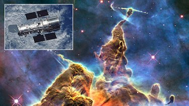 One of Hubble's best-known images - the vast Carina Nebula, an interstellar cloud of dust and gas 6500 light years away. Inset: At home, 570 kilometres above Earth.