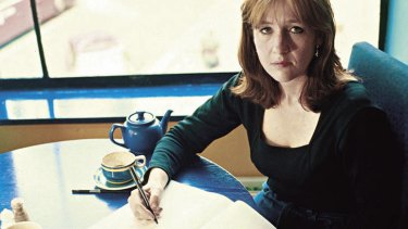 Where it began … Rowling re-creates her cafe-based writing technique for the cameras in 1999.