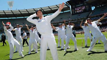 English players celebrate with a rendition of the ''sprinkler'' dance as Ricky Ponting ponders the loss.