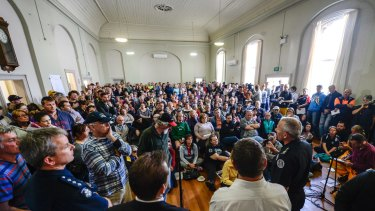 Officials front angry locals at a community meeting in Lancefield.