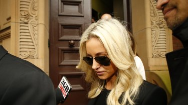 Oliver Curtis' wife Roxy Jacenko leaves court after her husband was jailed.