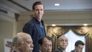 """Damian Lewis (standing) plays Wall Street hedge fund titan Bobby """"Axe"""" Axelrod in Billions."""
