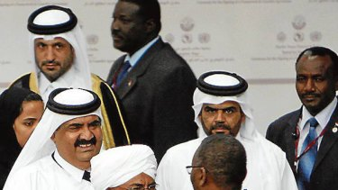 Agreement ... Omar al-Bashir, centre, embraces Khalil Ibrahim of the Justice and Equality Movement.