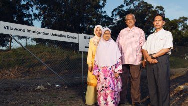Piah Samat, mother, and Noriatin Umar, sister of convicted killer Sirul Azhar Umar, with Malaysian opposition politicians outside Villawood detention centre.