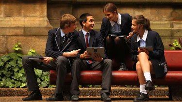 Screen test … Harry Sanderson, 14, Reggie Ridlen, 15, Claire Darwell, 15, and Helena Salomon, 14, with their iPad yesterday.