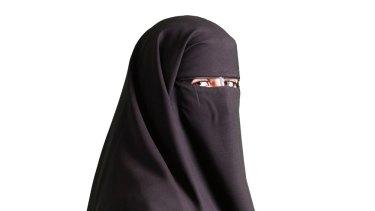 A woman wearing a black niqab.