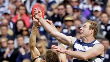 Steve Johnson spoils Eagles defender Beau Waters in a marking contest during the second preliminary final.