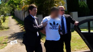 NSW Police arrest Kevin Ly over the alleged murders of drug cook Son Thanh Nguyen and girlfriend Thi Kim Lien Do in Canley Vale in 2013.