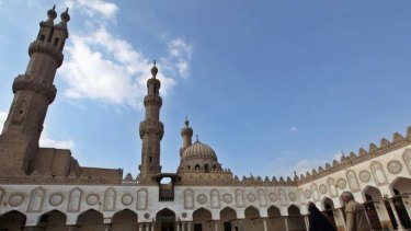 Counting down … as Egypt awaits the election results, Muslims attend prayer at Cairo's Al Azhar mosque.