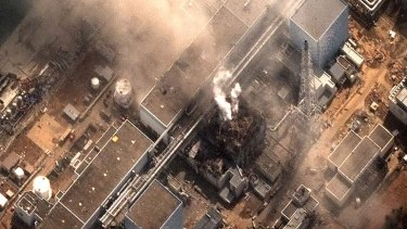 Risk of meltdown ... smoke comes out of the Fukushima Daiichi nuclear plant.
