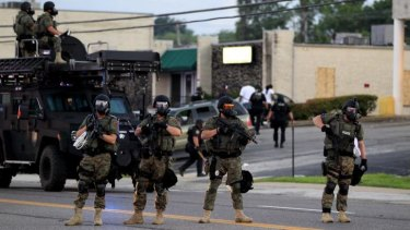 Riot police on the streets of St Louis in the aftermath of Michael Brown's shooting.