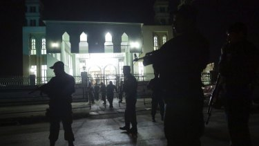 Security forces respond at the site of a suicide attack on a Shiite mosque in Kabul, Afghanistan.