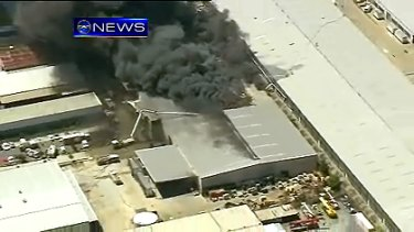 Firefighters continue to battle a large factory fire at an industrial estate at Geebung in Brisbane's north.