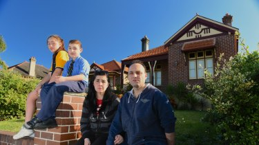 """""""You're in limbo"""": Joe Cavallaro with his wife, Vera, and children Alfio and Marchella, outside the Haberfield home they recently sold to the government."""