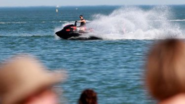 Jet-ski riders come close to the no-go zone at Port Melbourne after an accident at the same beach on Friday night.