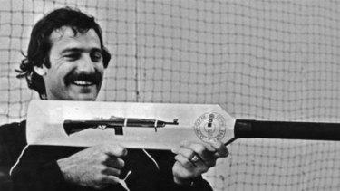 Dennis Lillee brandishes the controversial aluminium bat.