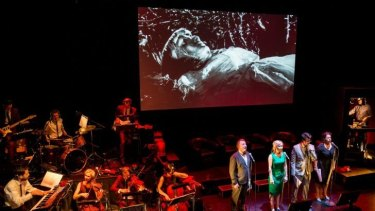 An orchestra plays the new score while a cast of four actors read the characters' lines live.