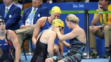 Superstar: Sarah Sjostrom (top) comforts Cate Campbell after her shock 100m freestyle final fourth place in Rio - now she has smashed the Australian's world record.