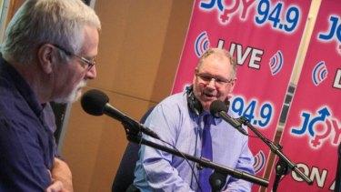 Neil Mitchell (left) and Robert Doyle help celebrate Joy's 21st anniversary.