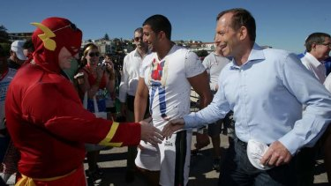 Tony Abbott meets The Flash at Bondi on Sunday.