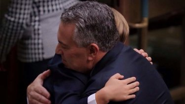 Treasurer Joe Hockey is hugged by his 8 year old son Xavier after he delivered his first budget. Photo: Andrew Meares
