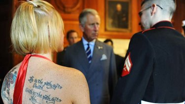 Life goes on ... Heather Nicely, left, stands with her husband, wounded US Marine Todd Nicely, as he greets Prince Charles at the British Embassy in Washington.