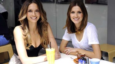 Happy in love: Ricki-Lee Coulter, pictured (left) with Kate Waterhouse, is about to start work on a new album.