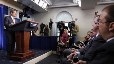 What's wrong with this picture? White House spokesman Jay Carney fronts the media during the daily briefing at the White House.