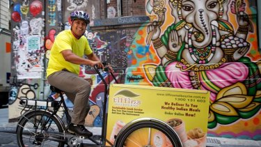 Food to go: Kedar Pednekar operates a pedal-powered lunchtime curry delivery service