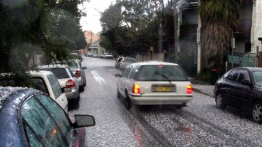 Potentially damaging hailstones litter Sydney's streets following a hailstorm.