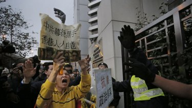 A protester shouts slogans outside the China Liaison Office in Hong Kong during a protest against the disappearance of the five men.