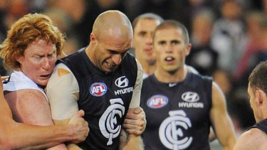 Cameron Ling wraps up Chris Judd in their 2009 clash.