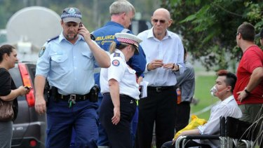 Treatment … Roger Dean is given oxygen by ambulance staff after Friday's fatal blaze at the Quakers Hill Nursing Home.