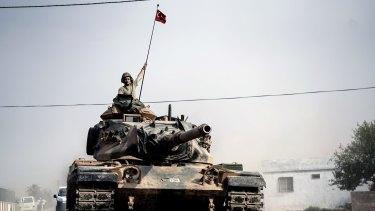 Turkish army tanks near the Syrian border at Karkamis.