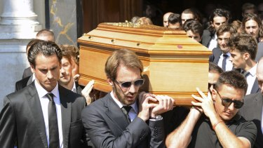 Formula One driver Jean Eric Vergne (centre), unidentified drivers and friends carry the coffin of late Marussia F1 driver Jules Bianchi at the end of the funeral ceremony.