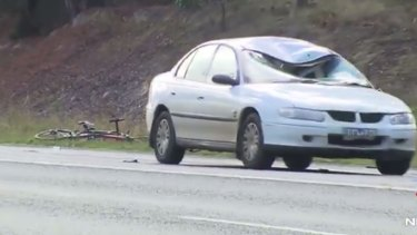 The white Holden involved in a crash with three cyclists in Macedon.