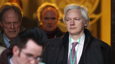 Silent … Assange refused to speak on leaving court in London.