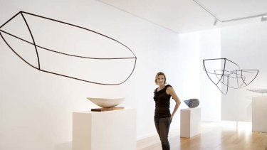 Scaled down … Dominique Sutton surrounded by works in her new exhibition, showing at the Tim Olsen Gallery.