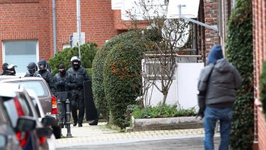 Arrests made: German special police in Alsdorf on Tuesday.