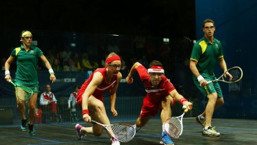 David Palmer and Rachael Grinham on their way to claiming gold for Australia in the mixed squash doubles against English duo Peter Barker and Alison Waters.