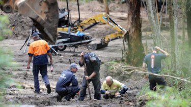Police search an area at Flat Rock Creek in East Gippsland yesterday where, after receiving 'credible evidence', they believe the body of Prue Bird may be buried.