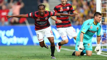 You beauty: Youssouf Hersi celebrates after putting the Wanderers 2-0 up on Monday night.