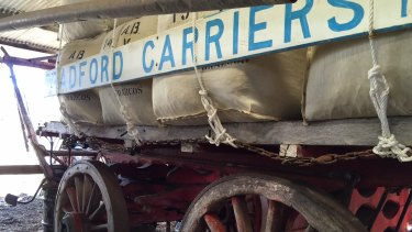 A sight of days gone by. This wool carriage is still pulled by five draft horses. Bradford Carriers have been around since the 1850s.
